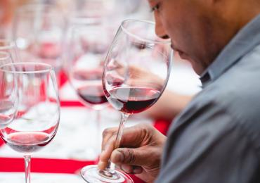 man using his sense of smell during a wine tasting experience